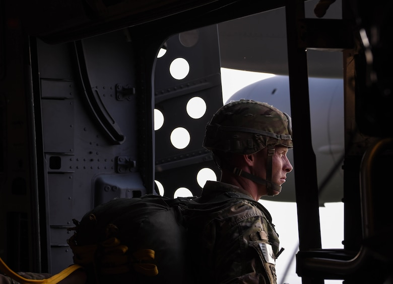 An 82nd Airborne Division jumpmaster waits for the green light to allow paratroopers to jump from a C-17 Globemaster III from McChord Field, Wash., during Exercise Predictable Iron near Pope Field, N.C., Aug. 21, 2018. Airmen from the 62nd Airlift Wing worked side-by-side with Soldiers to complete the exercise's mission. (U.S. Air Force photo by Senior Airman Tryphena Mayhugh)