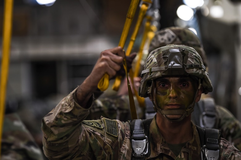 An 82nd Airborne Division paratroopers waits to jump out of a C-17 Globemaster III from McChord Field, Wash., during Exercise Predictable Iron near Pope Field, N.C., Aug. 21, 2018. Airmen from the 62nd Airlift Wing worked with the paratroopers during the exercise to help them maintain their airborne readiness requirements. (U.S. Air Force photo by Senior Airman Tryphena Mayhugh)