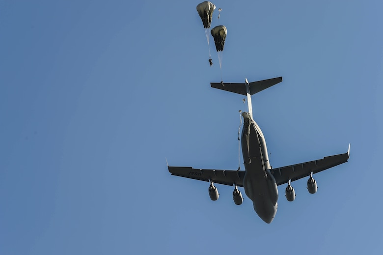 Paratroopers from the 82nd Airborne Division jump from a C-17 Globemaster III from McChord Field, Wash., during Exercise Predictable Iron at Pope Field, N.C., Aug 23, 2018. Airmen from the 62nd Airlift Wing dropped 1,005 paratroopers to keep the up-to-date with their airborne requirements. (U.S. Air Force photo by Senior Airman Tryphena Mayhugh)