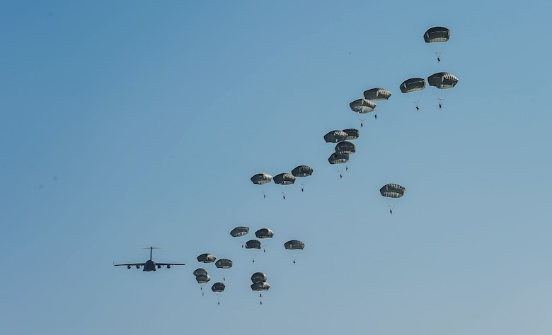 Paratroopers from the 82nd Airborne Division jump from a C-17 Globemaster III from McChord Field, Wash., during Exercise Predictable Iron at Pope Field, N.C., Aug 23, 2018. Over the course of three days, Airmen form the 62nd Airlift Wing dropped 1,005 paratroopers during the exercise. (U.S. Air Force photo by Senior Airman Tryphena Mayhugh)