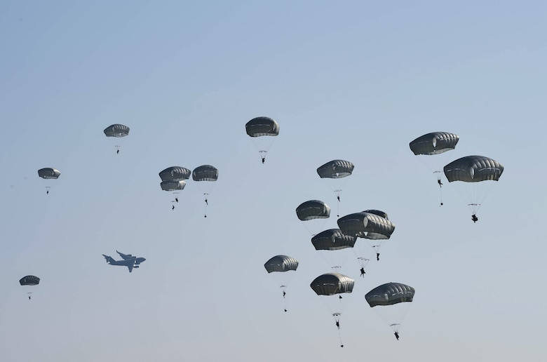Paratroopers from the 82nd Airborne Division jump from a C-17 Globemaster III from McChord Field, Wash., during Exercise Predictable Iron at Pope Field, N.C., Aug 23, 2018. Airmen from the 62nd Airlift Wing worked alongside the Army to drop equipment and personnel during the exercise. (U.S. Air Force photo by Senior Airman Tryphena Mayhugh)