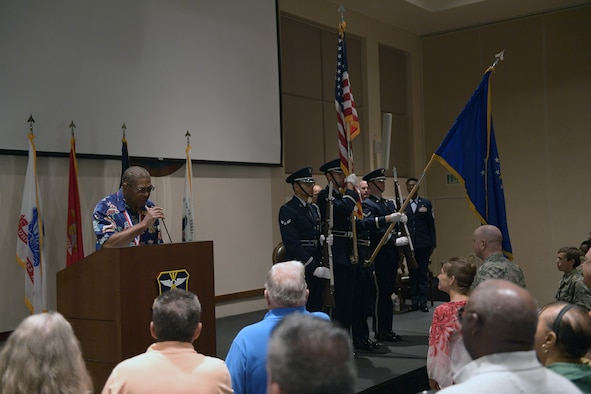 Ivan Taylor, far left, performs the singing of the National Anthem during the official portion of the Retiree Appreciation Day event at Buckley Air Force Base, Colorado, Aug. 25, 2018.