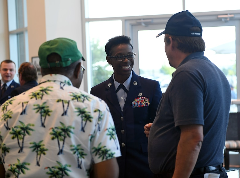 Chief Master Sgt. Tamar Dennis, 460th Space Wing command chief, speaks to attendees during the Retiree Appreciation Day event at Buckley Air Force Base, Colorado, Aug. 25, 2018.