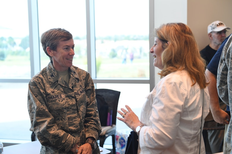 Col. Shannon Phares, 460th Medical Group commander, speaks to an attendee of the Retiree Appreciation Day event at Buckley Air Force Base, Colorado, Aug. 25, 2018.
