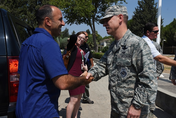 Air Base Wing Commander greets Rep. Jimmy Panetta.