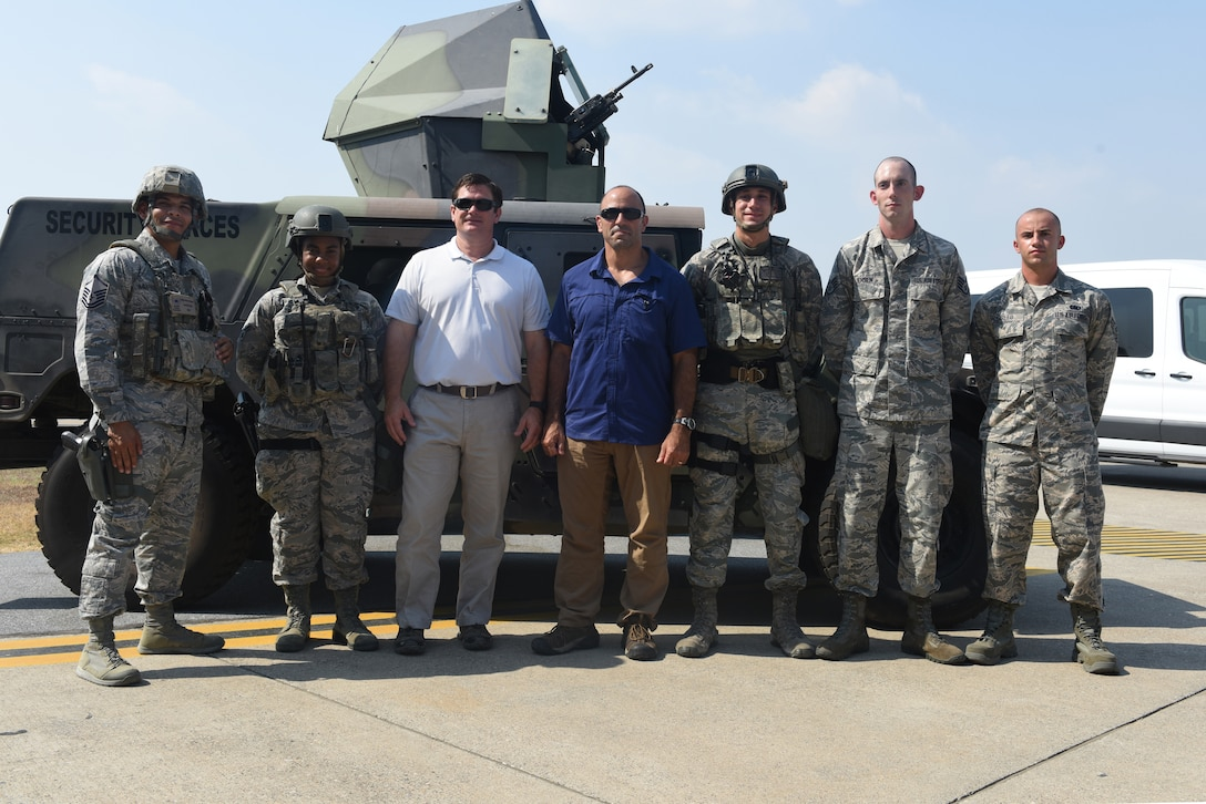 U.S. House Representatives pose with U.S. Airmen from Incirlik Air Base.