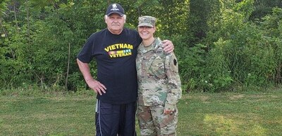 John Schilinski and his daughter, Army Staff Sgt. Rachel Kovach, a squad leader with the Pennsylvania Army National Guard's 2nd Platoon, Alpha Company, 1st Battalion, 112th Infantry Regiment, strengthened their family ties when Kovach became an infantry soldier. Pennsylvania Army National Guard photo by Maj. Gregory McElwain
