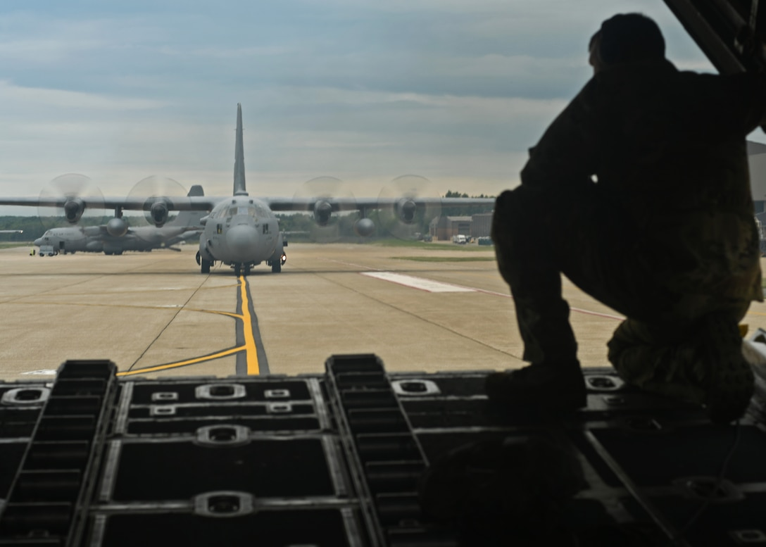 Staff Sgt. Jed Pickett, 700th Aerial Squadron loadmaster, talks with the pilot as a C-130 Hercules backs up on the military ramp at Youngstown Air Reserve Station, Ohio, Aug. 7, 2018. When backing an aircraft, the loadmasters are responsible for directing the pilots by looking out the back of the aircraft and communicating what to do. This is useful to navigate small or congested airfields that don't have much space, such as those that may be encountered in theater. (U.S. Air Force photo by Staff Sgt. Miles Wilson)