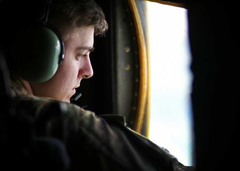 Senior Airman Trevor Armentrout, 700th Aerial Squadron loadmaster, scans outside of the aircraft for any discrepencies at Youngstown Air Reserve Station, Ohio, Aug. 6, 2018. Armentrout participated in Tac Week, a training hosted by the 910th Airlift Wing, where the 700th AS trained with the 908th AS and the 757th AS. (U.S. Air Force photo by Staff Sgt. Miles Wilson)