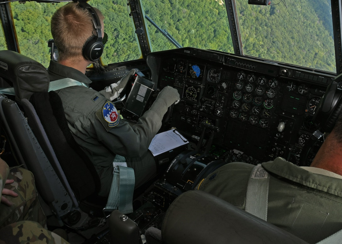 1st Lt. Harry Downing, 700th Aerial Squadron pilot, performs evasive aerial maneuvers in a C-130H3 Hercules outside of Youngstown Air Reserve Station, Ohio, Aug. 6, 2018. Downing, and the other aircrew members aboard, attended Tac Week training, hosted by the 910th Airlift Wing. The training involved the 908th AS and the 757th AS and consisted of various tactical scenarios and competitions between the squadrons. (U.S. Air Force photo by Staff Sgt. Miles Wilson)