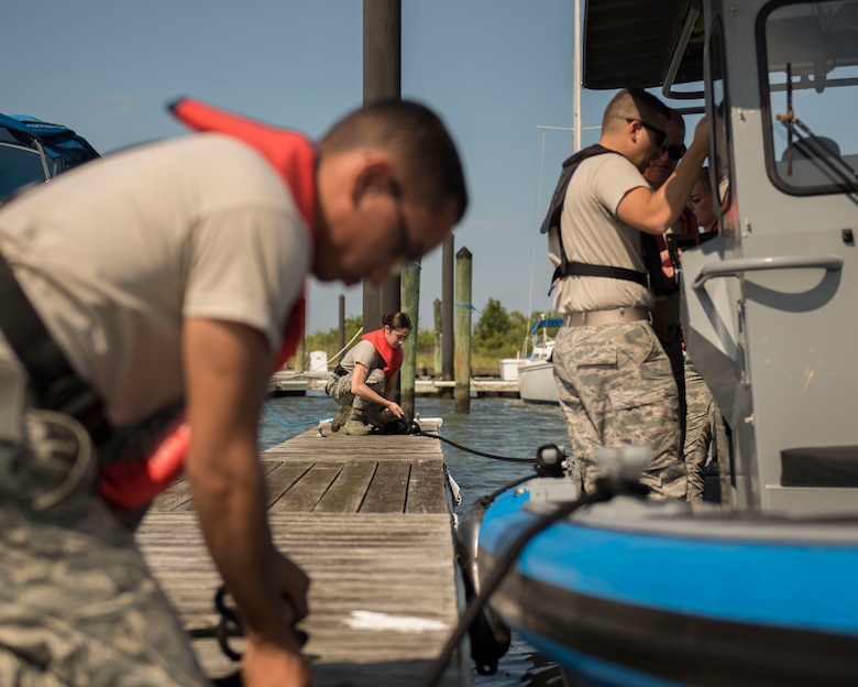 U.S. Air Force Airmen assigned to the 633rd Security Forces Squadron perform boat-docking procedures at Joint Base Langley-Eustis, Virginia, Aug. 14, 2018.