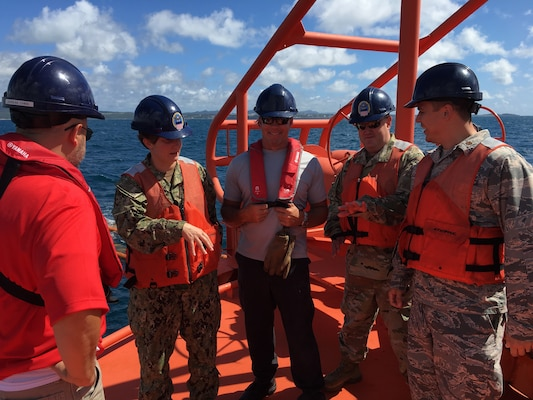 Personnel on ocean mooring, discussing