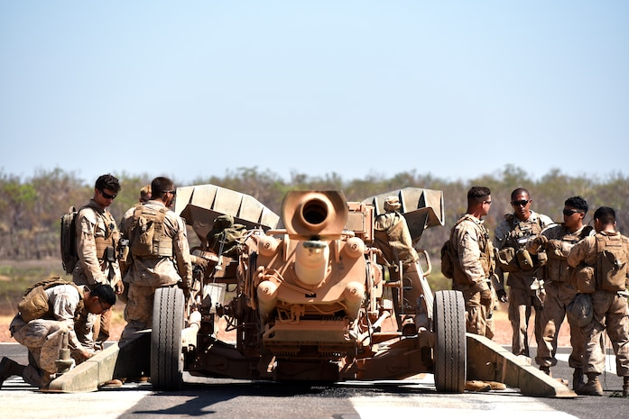Marines with Mike Battery, 3rd Battalion, 11th Marine Regiment, prepare their M777 Howitzer for aerial lift by an MV-22 Osprey with Marine Medium Tiltrotor Squadron 268 during Marine Rotational Force – Darwin's Exercise Koolendong at Mount Bundey Training Area, Australia, Aug. 25, 2018. This is the first time an Osprey has lifted and moved a Howitzer in the field in Australia and it is the first time an entire artillery battery deployed in support of MRF-D.