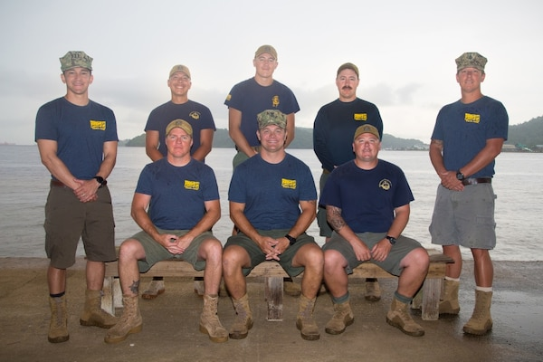 U.S. Navy divers pose for a photo.