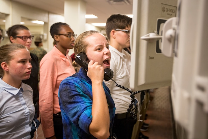 New recruits of Delta Company, 1st Recruit Training Battalion, and Papa Company, 4th Recruit Training Battalion, make a phone call home to inform family or friends that they have arrived safely on Parris Island, S.C., for recruit training July 16, 2018. Each recruit will get in contact with either their next-of-kin, or their recruiter upon arrival on the depot.