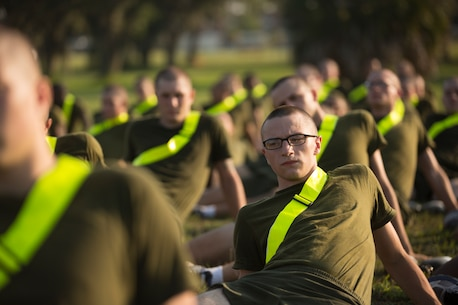 Rct. Ethan Gemzik, a native of Perkasie, Pa., performs a hip stretch after running for physical training Aug. 15, 2018, on Parris Island, S.C. Recruits must stretch after physical training in order to avoid any injuries.