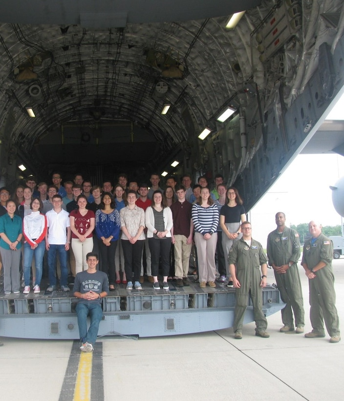 Wright Scholars pose on tail of a C-17 at Wright-Patterson Air Force Base. The Wright Scholar Program provides opportunities for high schoolers to explore and learn more about engineering, pre-medical sciences and other STEM disciplines. (Courtesy Photo)