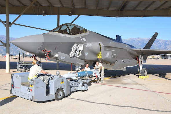 Maintainers from Hill's fighter wings load target munitions on an F-35 Lightning II during exercise Combat Hammer Aug. 8, 2018, at Hill Air Force Base, Utah.