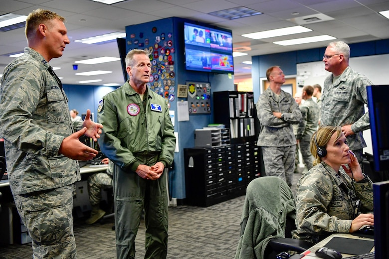 Capt. Jake Allenton, 225th Air Defense Squadron senior director, answers Gen. Terrence O'Shaughnessy, NORAD and USNORTHCOM commander, questions during his visit to the Western Air Defense Sector, Joint Base Lewis-McChord, Washington Aug. 23, 2018.  O'Shaughnessy received a tour of the operations floor and met with the WADS crew that provided command and control of the 142nd Fighter Wing's F-15 intercept of the Aug. 10 stolen Horizon Bombardier Q400 aircraft out of SeaTac International Airport. (U.S. Air National Guard photo by Maj. Kimberly D. Burke)