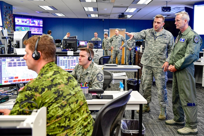 Master Sgt. Donald Pierce, 225th Air Defense Squadron air surveillance technician, answers Gen. Terrence O'Shaughnessy, NORAD and USNORTHCOM commander, questions during his visit to the Western Air Defense Sector, Joint Base Lewis-McChord, Washington Aug. 23, 2018.  O'Shaughnessy received a tour of the operations floor and met with the WADS crew that provided command and control of the 142nd Fighter Wing's F-15 intercept of the Aug. 10 stolen Horizon Bombardier Q400 aircraft out of SeaTac International Airport. (U.S. Air National Guard photo by Maj. Kimberly D. Burke)