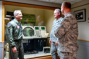 Col. William Krueger (center), 225th Air Defense Group commander, shows Gen. Terrence O'Shaughnessy, NORAD and USNORTHCOM commander, the technology the Western Air Defense Sector was using during the 9/11 attacks.  O'Shaughnessy met with the WADS operations crew that provided command and control of the 142nd Fighter Wing's F-15 intercept of the Aug. 10 stolen Horizon Bombardier Q400 aircraft out of SeaTac International Airport. (U.S. Air National Guard photo by Maj. Kimberly D. Burke)