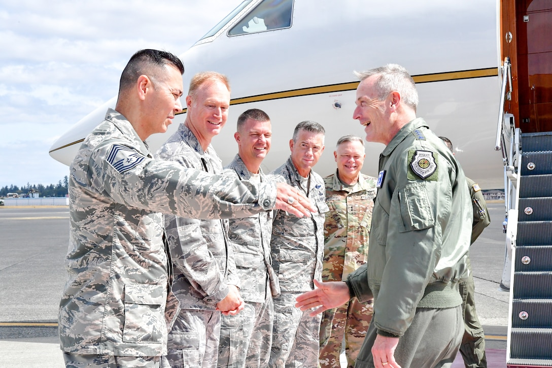 Chief Master Sgt. Allan Lawson, Western Air Defense Sector Senior Enlisted Leader, greets Gen. Terrence O'Shaughnessy, NORAD and USNORTHCOM commander, as he arrives to Joint Base Lewis-McChord, Washington Aug. 23, 2018.  O'Shaughnessy met with the Western Air Defense Sector operations crew that provided command and control of the 142nd Fighter Wing's F-15 intercept of the Aug. 10 stolen Horizon Bombardier Q400 aircraft out of SeaTac International Airport.  Also pictured from left to right are Col. Gregory Lewis, WADS commander, Col. Scovill Currin, 62nd Airlift Wing Commander,  Brig. Gen. Jeremy Horn, Washington Air National Guard Commander, and Maj. Gen. Bret Daugherty, The Adjutant General, Washington. (U.S. Air National Guard photo by Maj. Kimberly D. Burke)