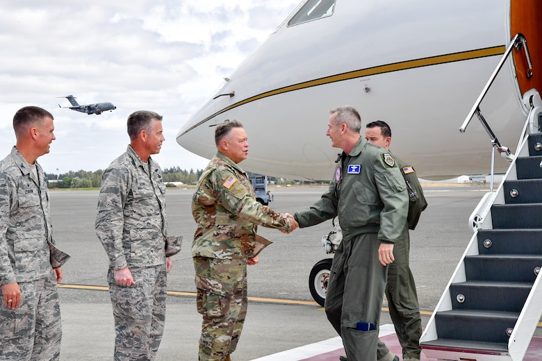 Maj. Gen. Bret Daughterty, The Adjutant General for Washington, greets Gen. Terrence O'Shaughnessy, NORAD and USNORTHCOM commander, as he arrives to Joint Base Lewis-McChord, Washington Aug. 23, 2018.  O'Shaughnessy met with the Western Air Defense Sector operations crew that provided command and control of the 142nd Fighter Wing's F-15 intercept of the Aug. 10 stolen Horizon Bombardier Q400 aircraft out of SeaTac International Airport.  Also pictured are Brig. Gen. Jeremy Horn, Washington Air National Guard Commander (second from left) and Col. Scovill Currin, 62nd Airlift Wing Commander (left).  (U.S. Air National Guard photo by Maj. Kimberly D. Burke)