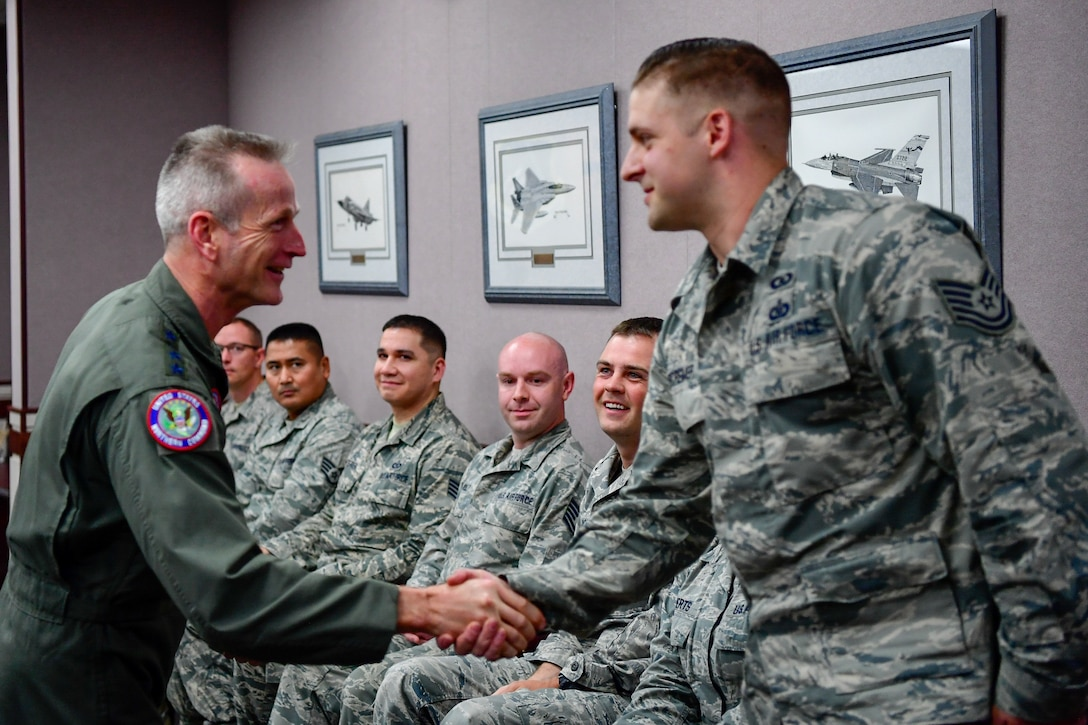 Gen. Terrence O'Shaughnessy, NORAD and USNORTHCOM commander, recognizes Tech. Sgt. Aaron DeCremer, 225th Air Defense Squadron weapons director, with a commander's coin for the critical role he played during the Aug. 10, 2018 F-15 fighter intercept of the stolen Horizon Bombardier Q400 aircraft out of SeaTac International Airport.  O'Shaughnessy visited the WADS Aug. 23 in order to commend the WADS operations crew for their expert command and control of the 142nd Fighter Wing's F-15 intercept of the stolen aircraft. (U.S. Air National Guard photo by Maj. Kimberly D. Burke)