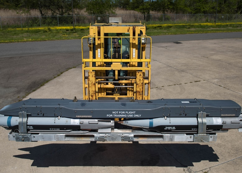 U.S. Air Force Airman 1st Class Ulysses Rodriguez, 1st Maintenance Squadron conventional maintenance technician, picks up GBU39A/B's with a forklift at Joint Base Langley-Eustis, Virginia, May 1, 2018.