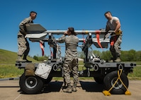 U.S. Air Force Airmen from the 1st Maintenance Squadron precision guided munitions unit, mount an AIM-9 Sidewinder missile at Joint Base Langley-Eustis, Virginia, April 30, 2018.