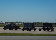 U.S. Air Force Airmen from the 1st Maintenance Squadron line delivery unit, bring trailers loaded with chaff to the flightline at Joint Base Langley-Eustis, Virginia, May 1, 2018.