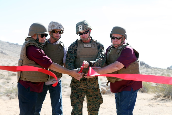 BGen Roger B. Turner Jr., Combat Center Commanding General, cuts the ribbon before the start of the live-fire training exercise conducted in the Galway Lake Training Area in the Johnson Valley Exclusive Military Use Area, Marine Corps Air Ground Combat Center, Twentynine Palms, Calif., Aug. 24, 2018. (Marine Corps photo by Kelly O'Sullivan)