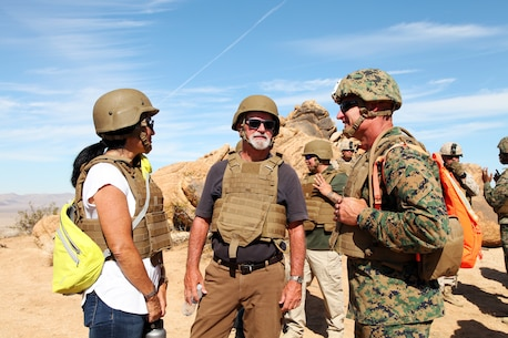 BGen Roger B. Turner, right, talks with Beth Bogue, left, Field Representative for California State Assemblyman Chad Mayes, and Jim Schooler, Field Representative for California State Sen. Jean Fuller, during live-fire training conducted by India Company, 3rd Battalion, 4th Marines, 7th Marine Regiment, in the Galway Lake Training Area in the Johnson Valley Exclusive Military Use Area, Marine Corps Air Ground Combat Center, Twentynine Palms, Calif., Aug. 24, 2018. (Marine Corps photo by Kelly O'Sullivan)