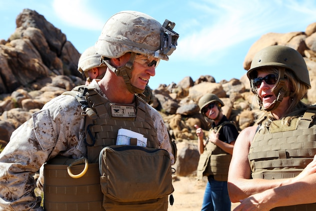 Col. Kyle B. Ellison, Commanding Officer, 7th Marine Regiment, talks with Dawn Rowe, Field Representative for Congressman Paul Cook, during live-fire training conducted by India Company, 3rd Battalion, 4th Marines, 7th Marine Regiment, in the Galway Lake Training Area in the Johnson Valley Exclusive Military Use Area, Marine Corps Air Ground Combat Center, Twentynine Palms, Calif., Aug. 24, 2018. (Marine Corps photo by Kelly O'Sullivan)