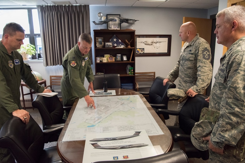 Col. D. Scott Durham, 439th Airlift Wing commander, points out places of interest on an aerial map of Westover Air Reserve Base to 436th Airlift Wing leadership Aug. 22, 2018, at Westover ARB, Mass. Westover is the largest Air Force Reserve base in the United States, employing more than 5,500 military and civilian personnel.  (U.S. Air Force photo by Staff Sgt. Zoe Russell)