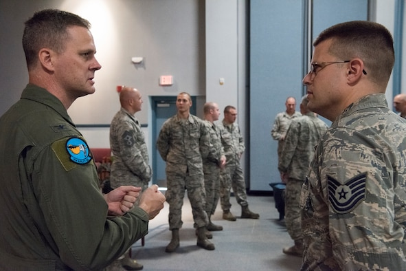 Col. Joel Safranek (left), 436th Airlift Wing commander, speaks with Tech. Sgt. Emmanuel Jacoby, 436th Maintenance Squadron, Operating Location Alpha, regional isochronal inspection floor chief, after a commander's call Aug. 23, 2018, at Westover Air Reserve Base, Mass. Safranek was one of six leaders from Dover Air Force Base, Del., who visited Airmen assigned to the geographically separated maintenance unit. (U.S. Air Force photo by Staff Sgt. Zoe Russell)