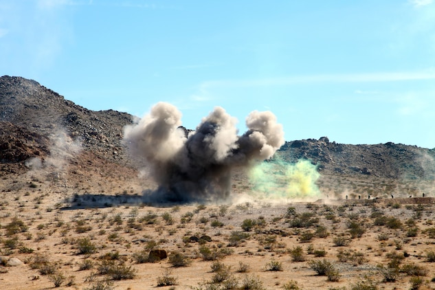 Impact from an Anti-Personnel Obstacle Breaching System (APOBS) throws up a large plume near an objective during live-fire training conducted by India Company, 3rd Battalion, 4th Marines, 7th Marine Regiment, in the Galway Lake Training Area in the Johnson Valley Exclusive Military Use Area, Marine Corps Air Ground Combat Center, Twentynine Palms, Calif., Aug. 24, 2018. (Marine Corps photo by Kelly O'Sullivan)