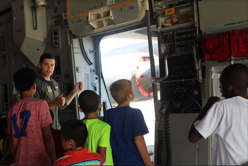 Airman 1st Class Garrett Lisenby, 15th Airlift Squadron loadmaster, explains how airdropping personnel out the troop doors works during an Aug. 10, 2018, STEMspiration camp visit to Joint Base Charleston, S.C.  The camp is sponsored by the Charleston County School District.