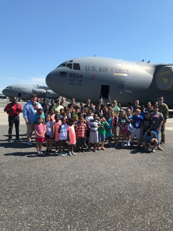 STEMspiration campers pose with members of the 15th Airlift Squadron in front a C-17 Globemaster III they explored during a visit to the flight line at Joint Base Charleston, S.C., Aug. 10, 2018. The camp is sponsored by the Charleston County School District.