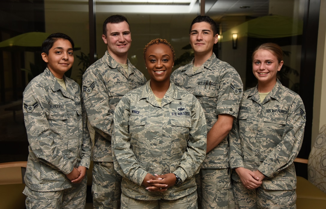 Airmen from the 81st Medical Group pose for a group photo at the Keesler Medical Center on Keesler Air Force Base, Mississippi, Aug. 28, 2018. Staff Sgt. Zsane Wrice, 81st Medical Group advanced cardiac life support pediatric advanced life support program administrator, front, Airman 1st Class Perla Hernandez Rodriguez, 81st Surgical Operations Squadron medical technician, left, Senior Airman Taylor Little and Airman 1st Class Enrique Padron, 81st Medical Operations Squadron medical technicians, and Senior Airman Ashley Elliott, 81st Inpatient Operation Squadron medical technician, were recognized after competing against 20 teams at the 11th Annual Air Force Emergency Medical Technician Rodeo Competition in Cannon Air Force Base, New Mexico, Aug. 8, 2018, while Wrice served as an evaluator. The two-day competition tested their knowledge and readiness training during high-stress scenarios. (U.S. Air Force photo by Kemberly Groue)