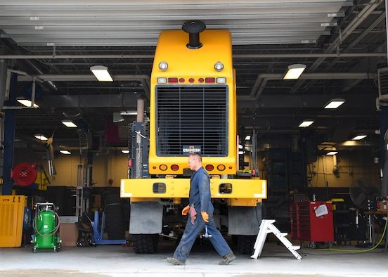 Paul Holien, 319th Logistics Readiness Squadron heavy equipment mobile mechanic, prepares to work on a snow plow August 28, 2018, on Grand Forks Air Force Base, North Dakota. The 319 LRS is essential for the maintenance of vehicles to include snow plows on Grand Forks AFB, which are crucial during winter months. Without the assistance of snow plows to keep snow from accruing on the base roads and flightline, normal operations would be impossible. (U.S. Air Force photo by Airman 1st Class Elora J. Martinez)