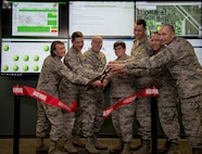 Col. Leslie Maher 375th Air Mobility Wing commander, and the official party cut the ribbon at the grand opening of the Cyber Operations Center, Aug. 23 2018 at Scott Air Force Base, Ill. The CyOC will act as a centralized reporting agency for over 14,000 users on Scott AFB, including it's vital mission partners.