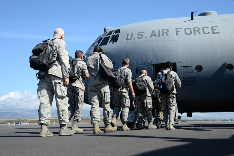 U.S. Air Force Airmen board a C-130 Hercules at Kahului Airport, Hawaii, for airlift to the island of Molokai for Tropic Care Maui County 2018, Hawaii, Aug. 10, 2018. Tropic Care Maui County 2018 is a joint service, hands-on readiness training mission that offered no-cost medical, dental and vision services to people at six locations across Maui, Molokai and Lanai from August 11-19. (U.S Air National Guard photo by Staff Sgt. Kevin Shulze)
