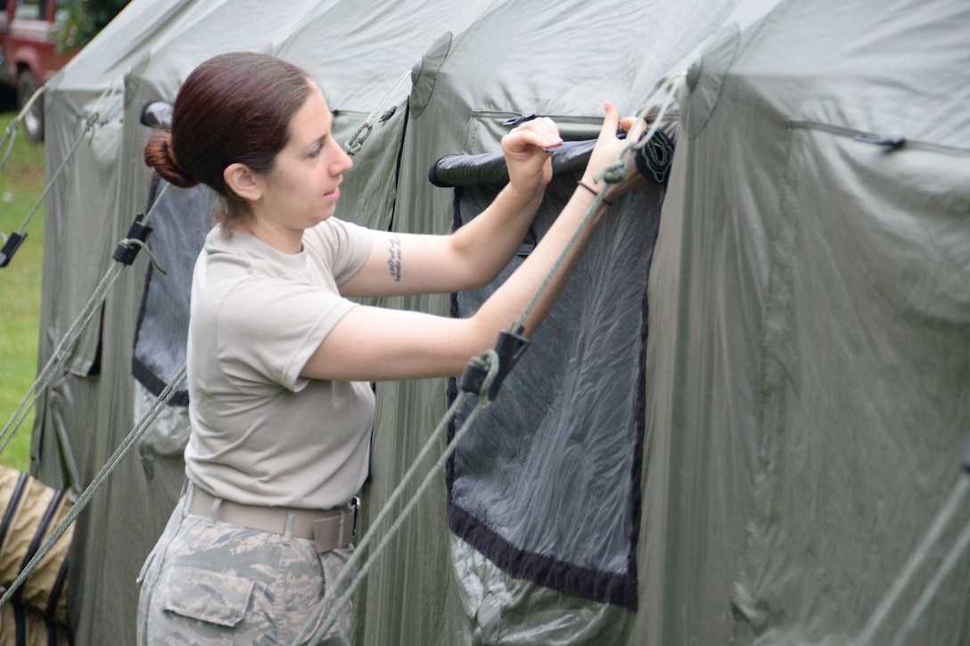 U.S. Air Force Staff Sgt. Caitlin Lee, a client systems technician assigned to the 158th Fighter Wing, Vermont Air National Guard, maintains a tent at the Hana clinic during Tropic Care Maui County 2018, Hawaii, Aug. 15, 2018. (U.S. Air National Guard photo by Staff Sgt. Kevin D. Schulze)
