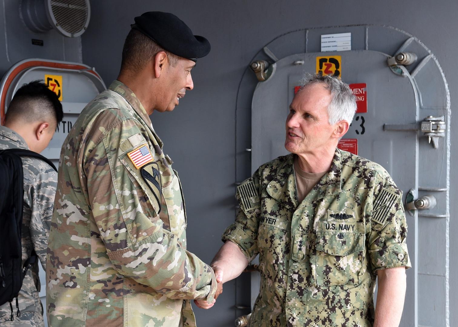 7th Fleet Leadership Welcomes U.S. Forces Korea aboard USS Blue Ridge