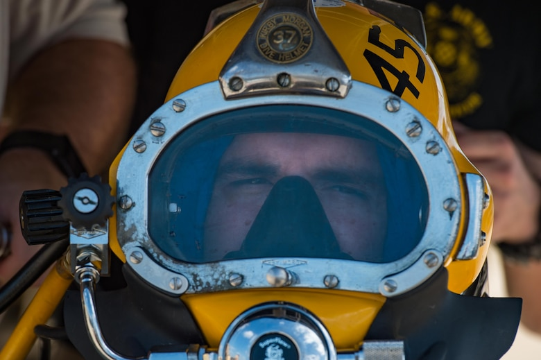 A 511th Engineer Dive Detachment Soldier secures his diving helmet during a dive supervisor qualification training scenario at Joint Base Langley-Eustis, Virginia, Aug. 22, 2018.