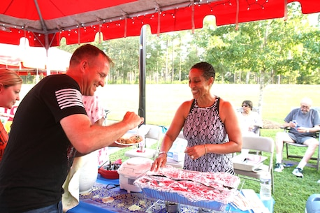 Several active-duty military families held the second annual International Evening under the Stars at Lincoln Military Housing on the base, August 25. The popular event not only unites the community but also shows appreciation for the melting pot of cultures aboard Marine Corps Logistics Base Albany.