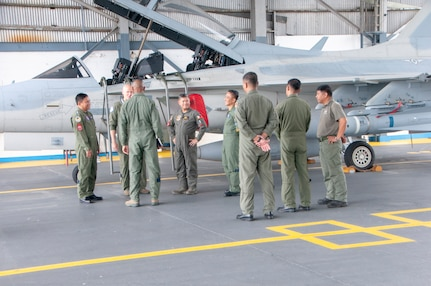 Philippine Air Force officials give a tour of the PAF's FA-50 fighter aircraft and facilities Aug. 9, 2018, Clark Air Force Base, Philippines. The tour was part of a subject matter expert exchange between the Philippine Air Force and the Hawaii Air National Guard as part of a National Guard State Partnership Program engagement.