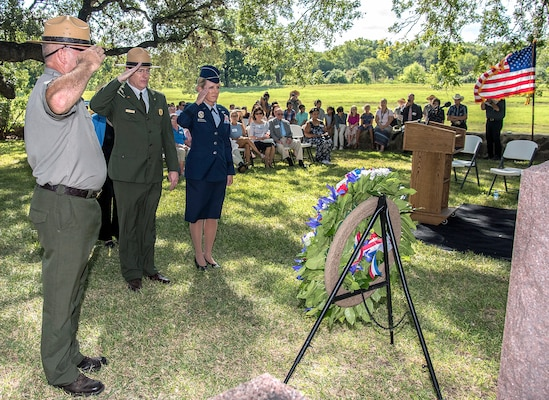 Brig. Gen. Laura Lenderman (right), 502nd Air Base Wing and Joint Base San Antonio commander, and (from left) Lyndon B. Johnson National Historical Park Ranger Patrick Pelarski and , Dave Schafer, chief of Interpretation and Resource Management for the Lyndon B. Johnson National Historical Park, salute the grave of President Lyndon B. Johnson Aug. 27 during a wreath-laying ceremony at LBJ National Historical Park. This year's event honored what would have been the 110th anniversary of President Johnson's birth.
