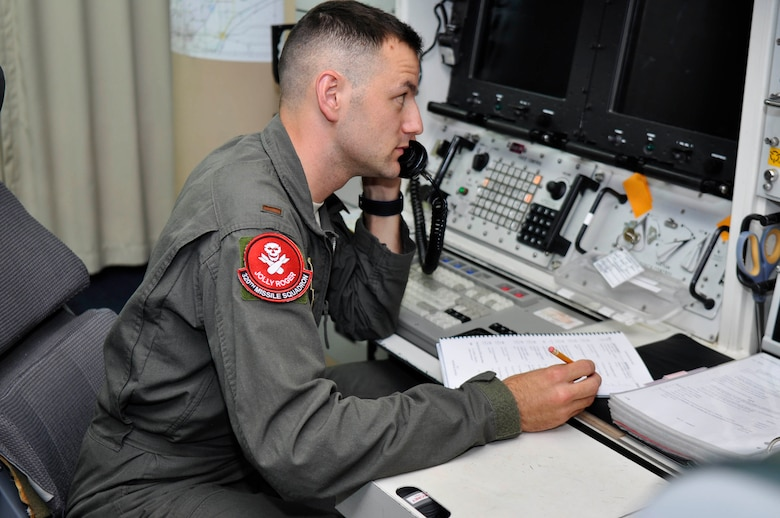Second Lieutenant Adam Pauley, 320th Missile Squadron deputy combat crew commander, communicates over the phone during a Simulated Electronic Launch-Minuteman test inside a launch control center at a missile alert facility in the 90th Missile Wing missile complex, Aug. 21, 2018. Accomplishing the SELM validates these claims and increases the deterrent capability of the Minuteman III ICBM weapon system. (U.S. Air Force photo by Senior Airman Breanna Carter)